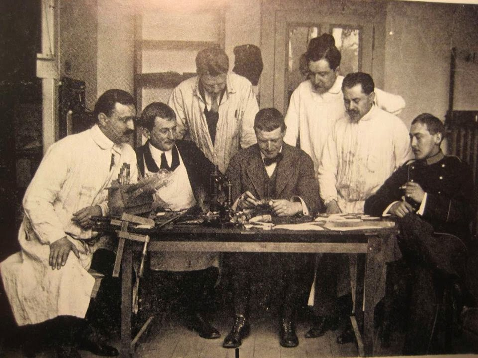 Dr. Archibald Reiss at table with other doctors